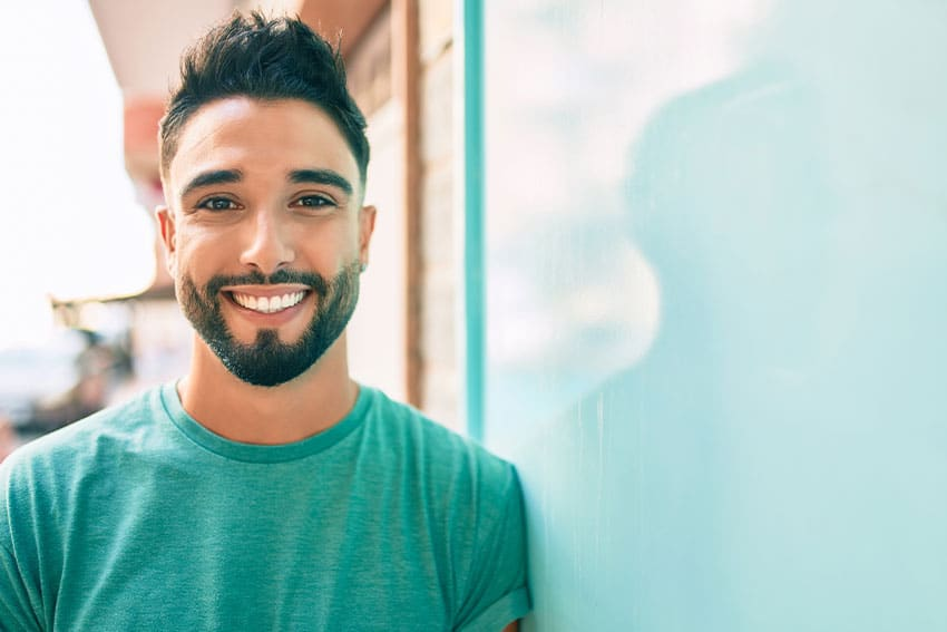 confident young man showing off his natural looking smile